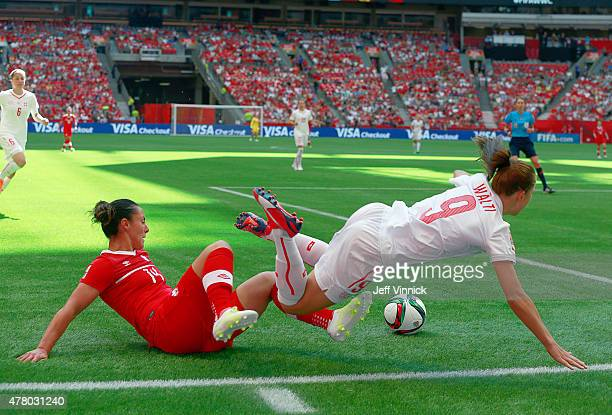 Melissa Tancredi of Canada knocks Lia Walti of Switzerland to the ground as they chase after the ball during the FIFA Women's World Cup Canada 2015...
