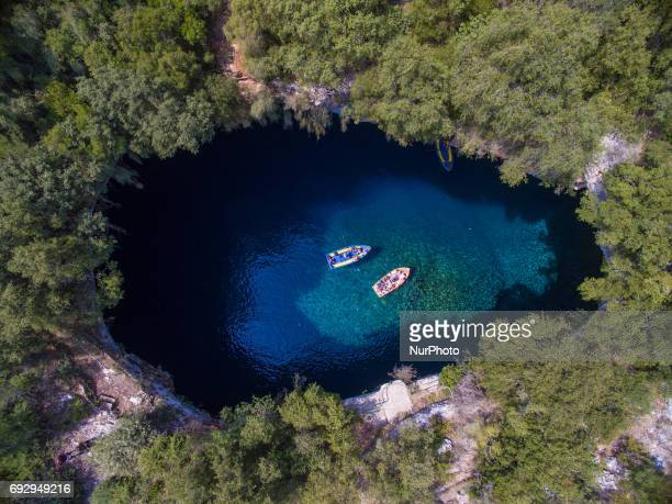 Melissani cave is known from ancient Greece as there is a temple inside the cavelake Today tourists can visit the famous cave and have a boat trip...