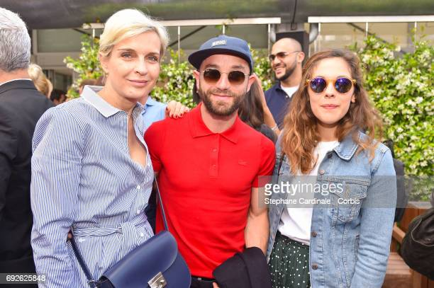 Melita Toscan Du Plantier Guillaume Gouix and Alysson Paradis attend the 2017 French Tennis Open Day Nine at Roland Garros on June 5 2017 in Paris...