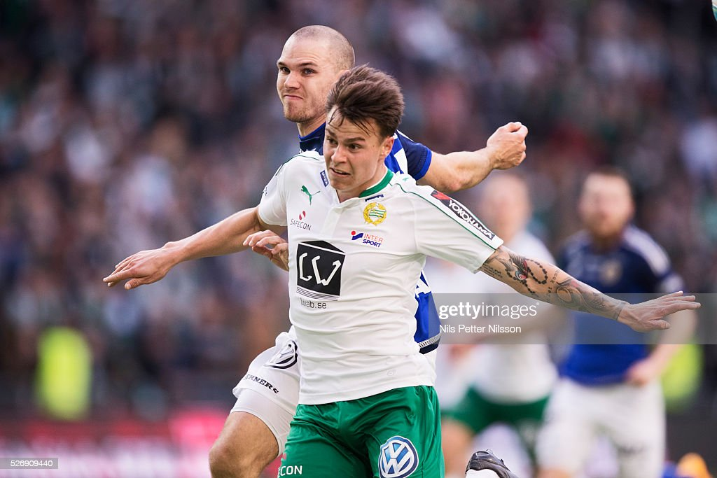 Melker Hallberg of Hammarby IF and Marcus Danielsson of GIF Sundsvall competes for the ball during the Allsvenskan match between Hammarby IF and GIF Sundsvall at Tele2 Arena on May 1, 2016 in Stockholm, Sweden.