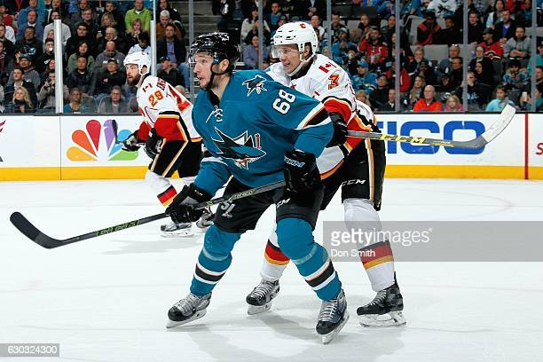 Melker Karlsson of the San Jose Sharks and Jyrki Jokipakka of the Calgary Flames look during a NHL game at SAP Center at San Jose on December 20 2016...