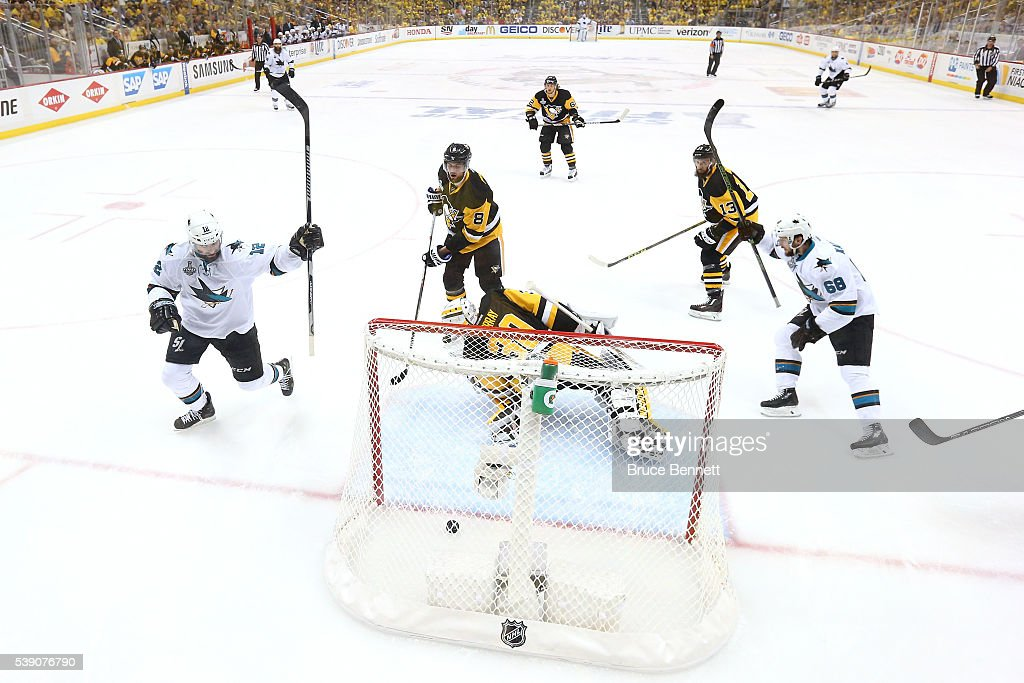 Melker Karlsson of the San Jose Sharks celebrates with his teammates after scoring a goal against Matt Murray of the Pittsburgh Penguins during the...