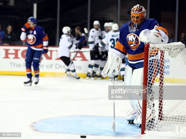Melker Karlsson of the San Jose Sharks celebrates with his teammates after scoring a goal against Jaroslav Halak of the New York Islanders in the...