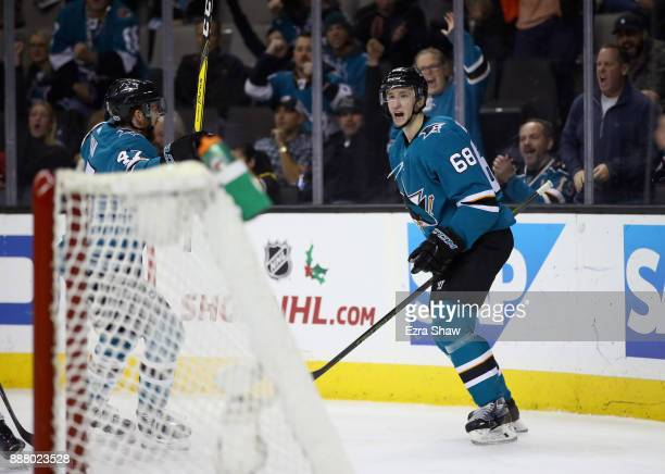 Melker Karlsson of the San Jose Sharks celebrates wth Joakim Ryan of the San Jose Sharks after Karlsson scored a shorthanded goal against the...