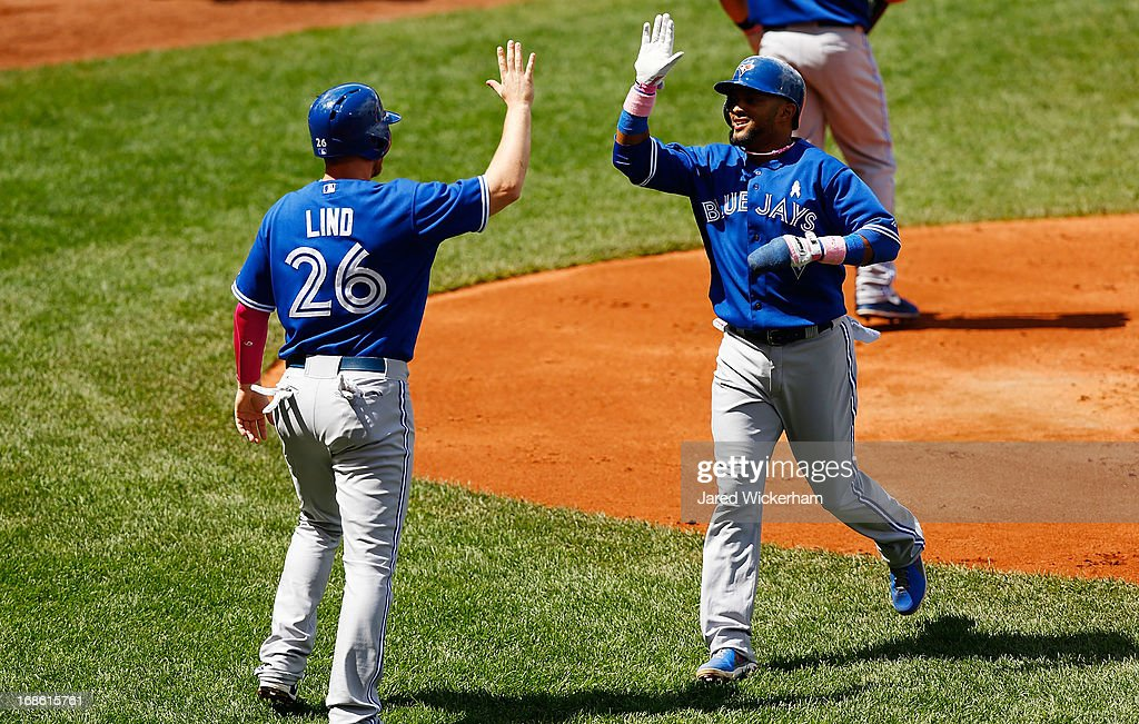 Melky Cabrera #53 and Adam Lind #26 of the Toronto Blue Jays celebrate after scoring in the second inning against the Boston Red Sox during the game on May 12, 2013 at Fenway Park in Boston, Massachusetts.