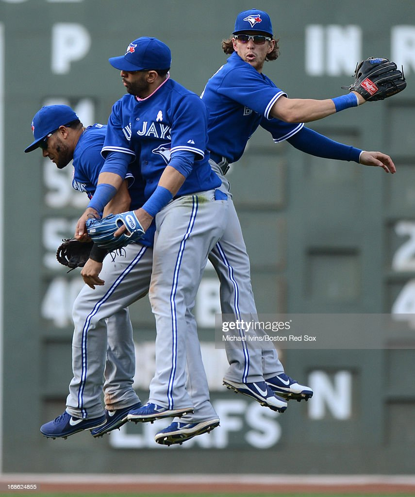 <a gi-track='captionPersonalityLinkClicked' href=/galleries/search?phrase=Melky+Cabrera&family=editorial&specificpeople=453444 ng-click='$event.stopPropagation()'>Melky Cabrera</a> #53, Jose Bautista #19 and <a gi-track='captionPersonalityLinkClicked' href=/galleries/search?phrase=Colby+Rasmus&family=editorial&specificpeople=3988372 ng-click='$event.stopPropagation()'>Colby Rasmus</a> #28 celebrate a 12-4 win over the Boston Red Sox on May 12, 2013 at Fenway Park in Boston, Massachusetts.
