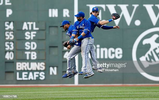 Melky Cabrera Jose Bautista and Colby Rasmus of the Toronto Blue Jays celebrate in center field following their 124 win against the Boston Red Sox...