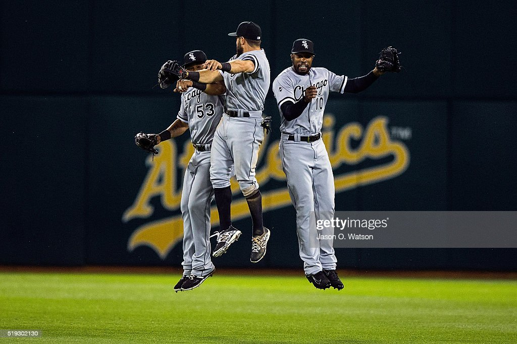 Melky Cabrera of the Chicago White Sox Adam Eaton and Austin Jackson celebrate after the game against the Oakland Athletics at the Oakland Coliseum...