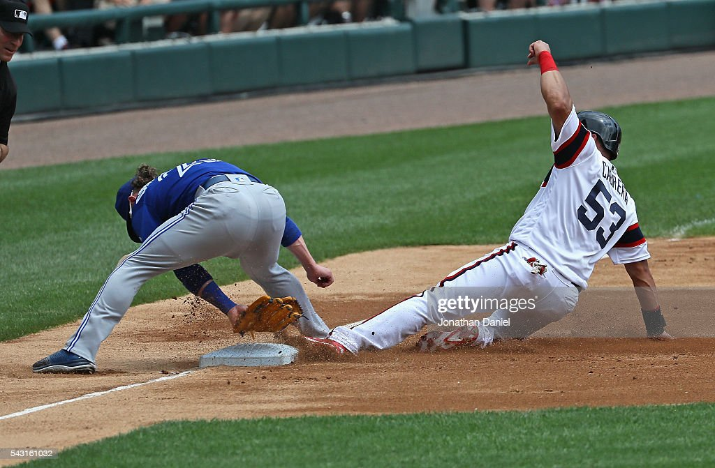 Melky Cabrera #53 of the Chicago White Sox appears to safely slide into third base as Josh Donaldson #20 of the Toronto Blue Jays attempts to make the tag between his legs at U.S. Cellular Field on June 26, 2016 in Chicago, Illinois.