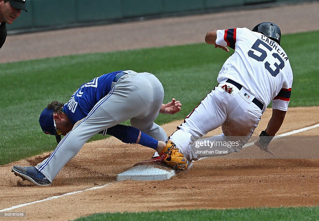 <a gi-track='captionPersonalityLinkClicked' href=/galleries/search?phrase=Melky+Cabrera&family=editorial&specificpeople=453444 ng-click='$event.stopPropagation()'>Melky Cabrera</a> #53 of the Chicago White Sox appears to safely slide into third base as <a gi-track='captionPersonalityLinkClicked' href=/galleries/search?phrase=Josh+Donaldson&family=editorial&specificpeople=4959442 ng-click='$event.stopPropagation()'>Josh Donaldson</a> #20 of the Toronto Blue Jays attempts to make the tag between his legs at U.S. Cellular Field on June 26, 2016 in Chicago, Illinois.