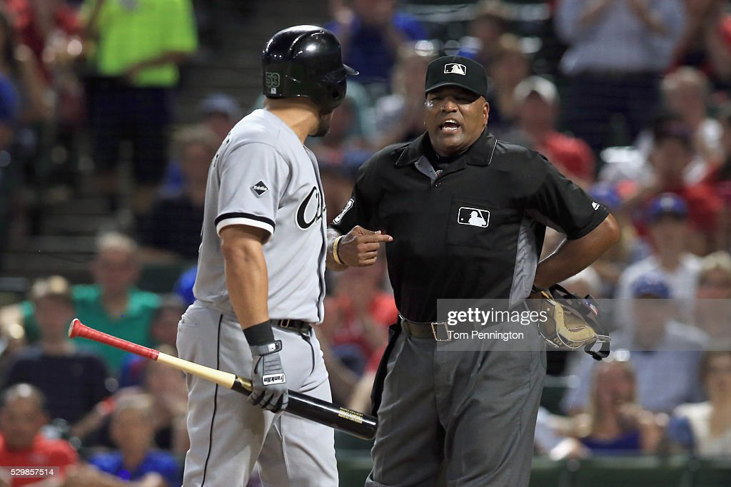 Melky Cabrera of the Chicago White Sox argues with home plate umpire Laz Diaz and is ejected from the game against the Texas Rangers in the top of...