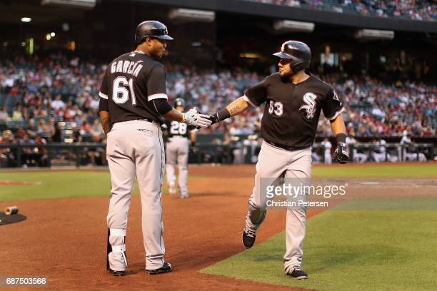 Melky Cabrera of the Chicago White Sox celebrates with Willy Garcia after hitting a solo home run against the Arizona Diamondbacks during the second...