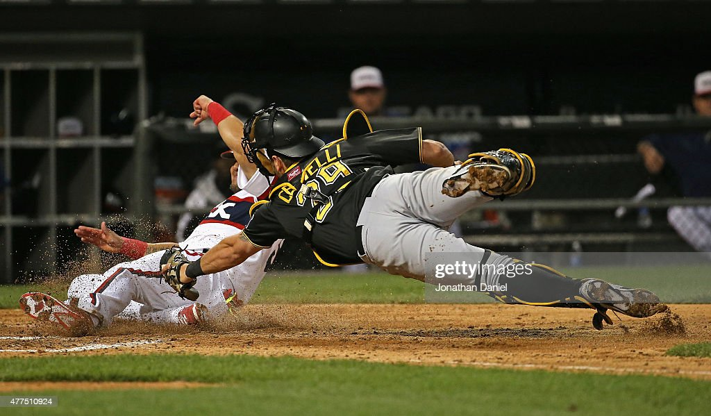 <a gi-track='captionPersonalityLinkClicked' href=/galleries/search?phrase=Melky+Cabrera&family=editorial&specificpeople=453444 ng-click='$event.stopPropagation()'>Melky Cabrera</a> #53 of the Chicago White Sox crosses the plate to score a run in the 6th inning as <a gi-track='captionPersonalityLinkClicked' href=/galleries/search?phrase=Francisco+Cervelli&family=editorial&specificpeople=4172506 ng-click='$event.stopPropagation()'>Francisco Cervelli</a> #29 of the Pittsburgh Pirates dives trying to make the tag at U.S. Cellular Field on June 17, 2015 in Chicago, Illinois.
