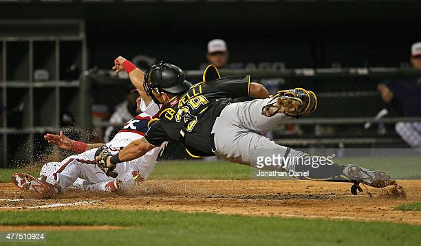 Melky Cabrera of the Chicago White Sox crosses the plate to score a run in the 6th inning as Francisco Cervelli of the Pittsburgh Pirates dives...