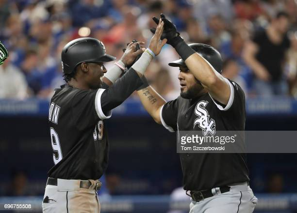 Melky Cabrera of the Chicago White Sox is congratulated by Alen Hanson after hitting a threerun home run in the fifth inning during MLB game action...