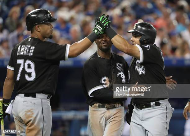 Melky Cabrera of the Chicago White Sox is congratulated by Alen Hanson and Jose Abreu after hitting a threerun home run in the fifth inning during...