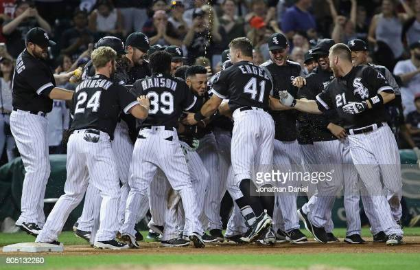 Melky Cabrera of the Chicago White Sox is mobbed by teammates after hitting the game winning two run walkoff single in the 9th ininng against the...