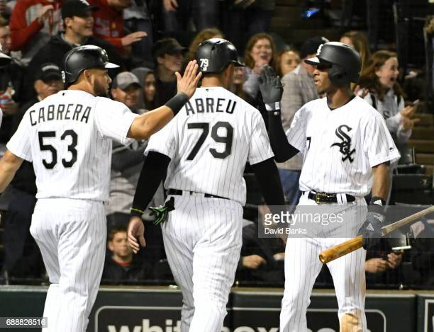 Melky Cabrera of the Chicago White Sox Jose Abreu are greeted by Tim Anderson after scoring against the Detroit Tigers during the third inning in...