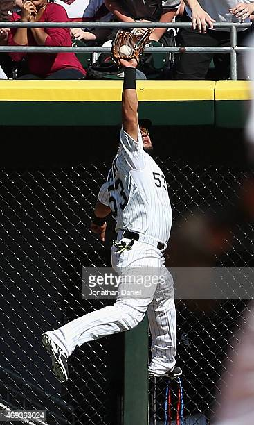 Melky Cabrera of the Chicago White Sox makes a leaping catch on a ball hit by Joe Mauer of the Minnesota Twins in the 5th inning at US Cellular Field...