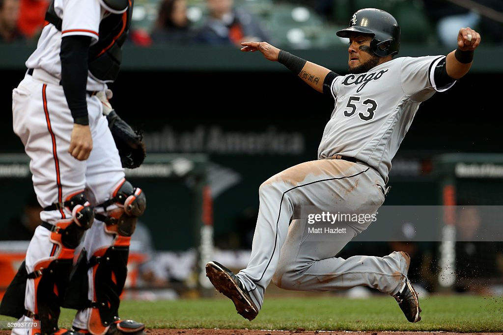 Melky Cabrera #53 of the Chicago White Sox scores off of a sacrifice fly hit by Dioner Navarro (not pictured) #27 of the Chicago White Sox in the ninth inning against the Baltimore Orioles at Oriole Park at Camden Yards on May 1, 2016 in Baltimore, Maryland.