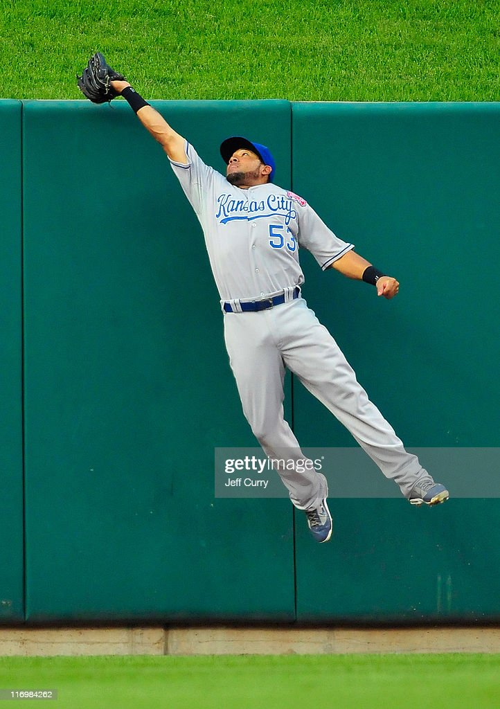 <a gi-track='captionPersonalityLinkClicked' href=/galleries/search?phrase=Melky+Cabrera&family=editorial&specificpeople=453444 ng-click='$event.stopPropagation()'>Melky Cabrera</a> #53 of the Kansas City Royals leap at the wall and catches a ball hit by <a gi-track='captionPersonalityLinkClicked' href=/galleries/search?phrase=Lance+Berkman&family=editorial&specificpeople=167176 ng-click='$event.stopPropagation()'>Lance Berkman</a> #12 of the St. Louis Cardinals at Busch Stadium on June 18, 2011 in St. Louis, Missouri.