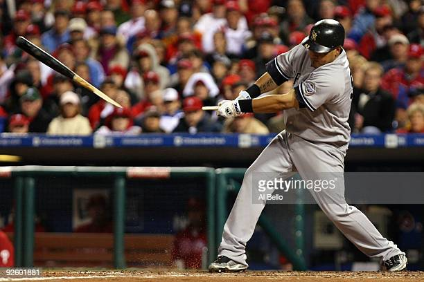 Melky Cabrera of the New York Yankees breaks his bat while hitting against the Philadelphia Phillies in Game Four of the 2009 MLB World Series at...