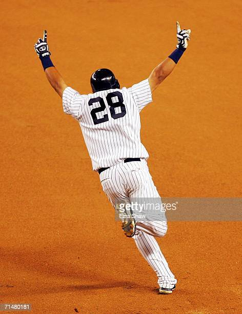 Melky Cabrera of the New York Yankees celebrates as he rounds first base after hitting a walkoff home run for the Yankees to beat the Seattle...