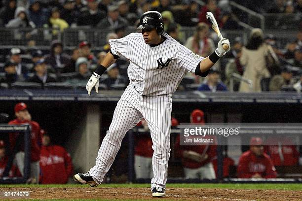 Melky Cabrera of the New York Yankees reacts after he flied out in the bottom of the sixth inning against the Philadelphia Phillies in Game One of...