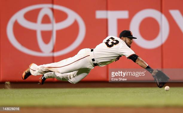 Melky Cabrera of the San Francisco Giants dives but can not catch a ball hit by Juan Pierre of the Philadelphia Phillies in the ninth inning at ATT...