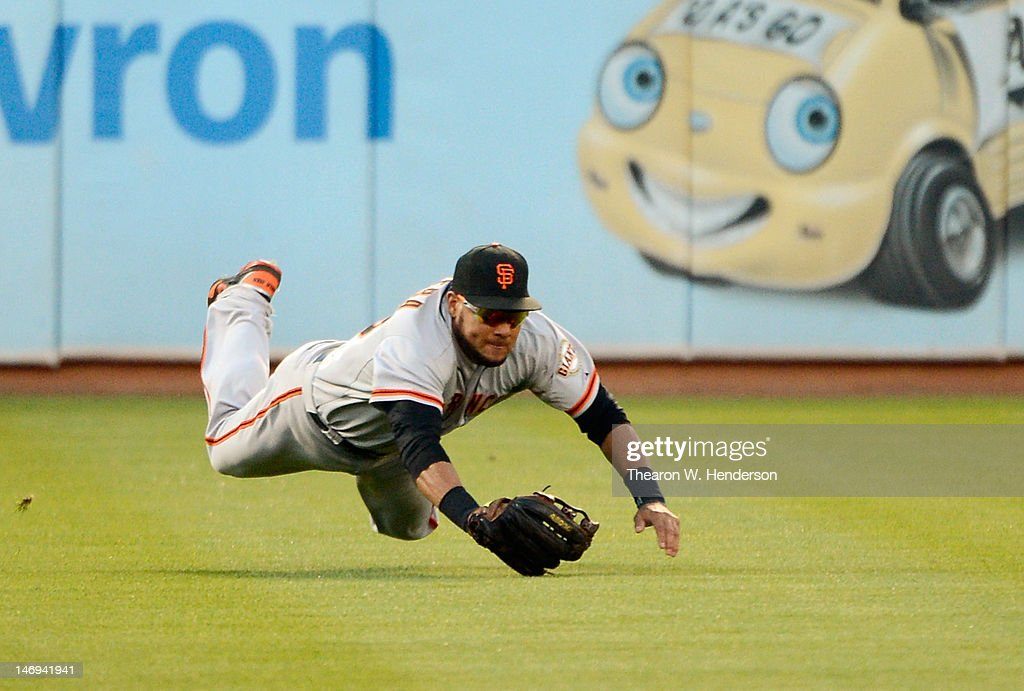 <a gi-track='captionPersonalityLinkClicked' href=/galleries/search?phrase=Melky+Cabrera&family=editorial&specificpeople=453444 ng-click='$event.stopPropagation()'>Melky Cabrera</a> #53 of the San Francisco Giants dives but can't catch the ball that goes for an RBI single off the bat of Derek Norris #36 of the Oakland Athletics in the ninth inning at O.co Coliseum on June 23, 2012 in Oakland, California.