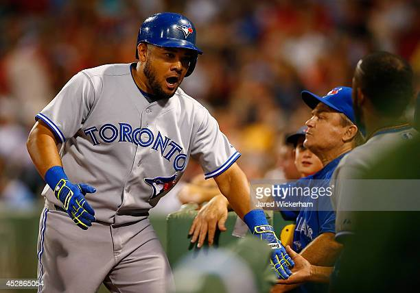 Melky Cabrera of the Toronto Blue Jays celebrates after hitting his second home run in the sixth inning against the Boston Red Sox during the game at...