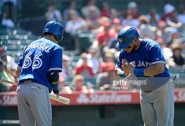 Melky Cabrera of the Toronto Blue Jays celebrates his run with Munenori Kawasaki to take a 76 lead during the sixth inning at Angel Stadium of...