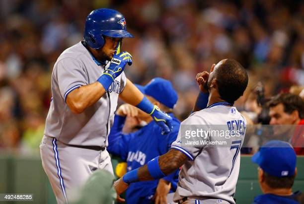 Melky Cabrera of the Toronto Blue Jays celebrates his solo home run in the sixth inning with teammate Jose Reyes against the Boston Red Sox during...