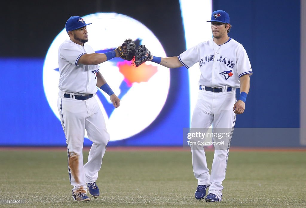 <a gi-track='captionPersonalityLinkClicked' href=/galleries/search?phrase=Melky+Cabrera&family=editorial&specificpeople=453444 ng-click='$event.stopPropagation()'>Melky Cabrera</a> #53 of the Toronto Blue Jays celebrates their victory with <a gi-track='captionPersonalityLinkClicked' href=/galleries/search?phrase=Colby+Rasmus&family=editorial&specificpeople=3988372 ng-click='$event.stopPropagation()'>Colby Rasmus</a> #28 during MLB game action against the Chicago White Sox on June 26, 2014 at Rogers Centre in Toronto, Ontario, Canada.