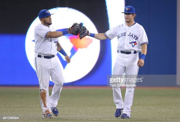 Melky Cabrera of the Toronto Blue Jays celebrates their victory with Colby Rasmus during MLB game action against the Chicago White Sox on June 26...