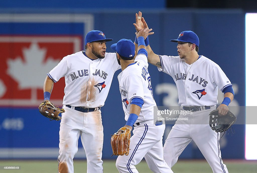 <a gi-track='captionPersonalityLinkClicked' href=/galleries/search?phrase=Melky+Cabrera&family=editorial&specificpeople=453444 ng-click='$event.stopPropagation()'>Melky Cabrera</a> #53 of the Toronto Blue Jays celebrates their victory with Jose Bautista #19 and <a gi-track='captionPersonalityLinkClicked' href=/galleries/search?phrase=Colby+Rasmus&family=editorial&specificpeople=3988372 ng-click='$event.stopPropagation()'>Colby Rasmus</a> #28 during MLB game action against the Houston Astros on April 9, 2014 at Rogers Centre in Toronto, Ontario, Canada.