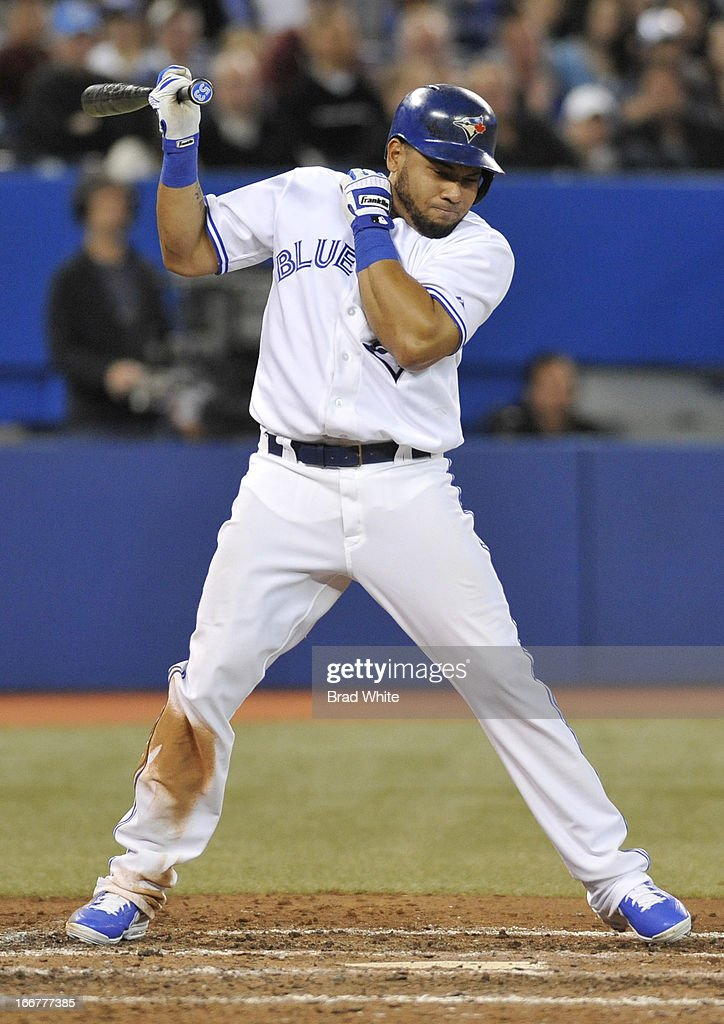 Melky Cabrera #53 of the Toronto Blue Jays reacts to an inside pitch during MLB-game action against the Chicago White Sox April 16, 2013 at Rogers Centre in Toronto, Ontario, Canada.