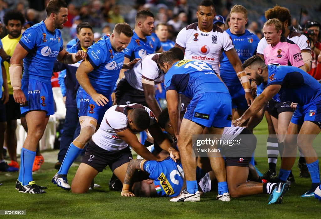 A melle errupts just before half time during the 2017 Rugby League World Cup match between Fiji and Italy at Canberra Stadium on November 10, 2017 in Canberra, Australia.