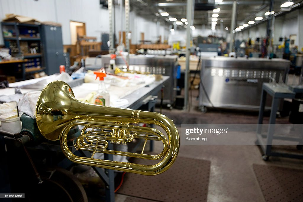 A mellophone waits to be completed at a work station in the manufacturing department of the E.K Blessing Co. in Elkhart, Indiana, U.S., on Thursday, Feb. 7, 2013. Photographer: Ty Wright/Bloomberg via Getty Images