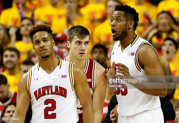 Melo Trimble and Damonte Dodd of the Maryland Terrapins react to a call as Alex Illikainen of the Wisconsin Badgers looks on in the second half at...
