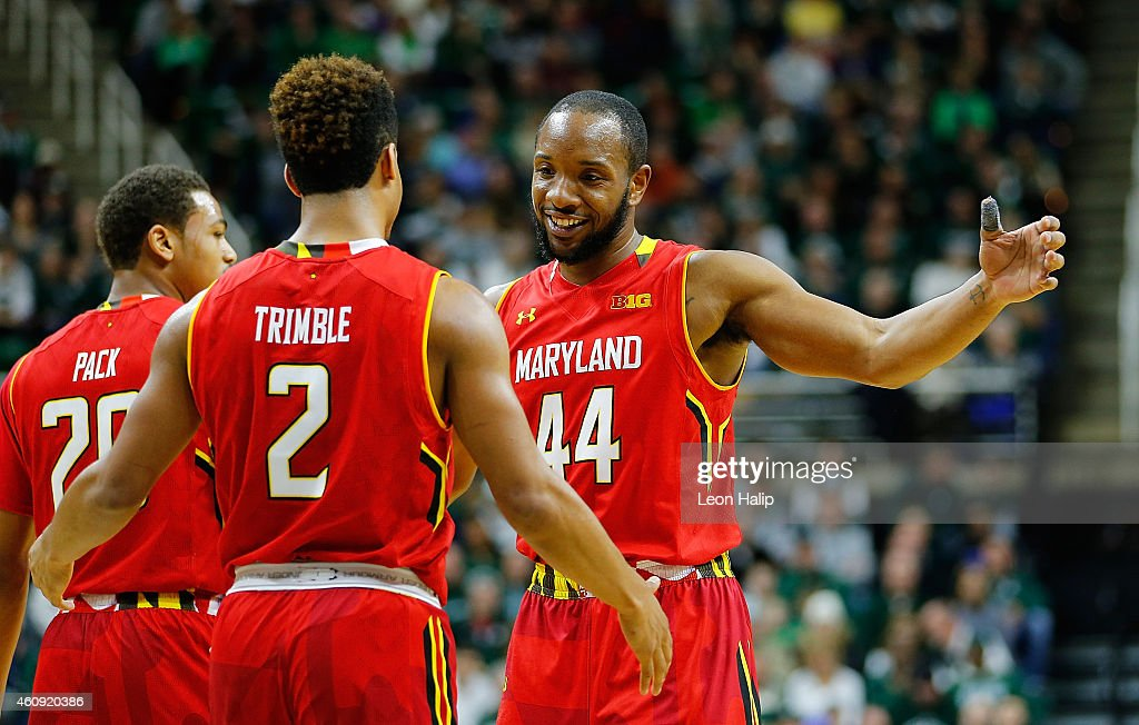 Melo Trimble and Dez Wells of the Maryland Terrapins celebrate a win over the Michigan State Spartans at the Breslin Center on December 30 2014 in...