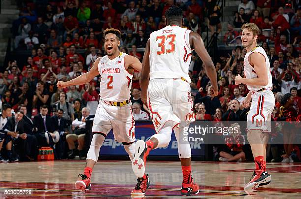 Melo Trimble Diamond Stone and Jake Layman of the Maryland Terrapins celebrate during the game against the Penn State Nittany Lions at the Xfinity...