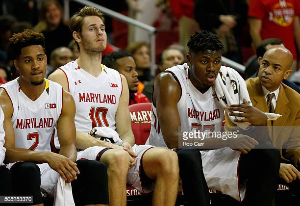 Melo Trimble Jake Layman and Diamond Stone of the Maryland Terrapins look on from the bench in the second half against the Ohio State Buckeyes at...