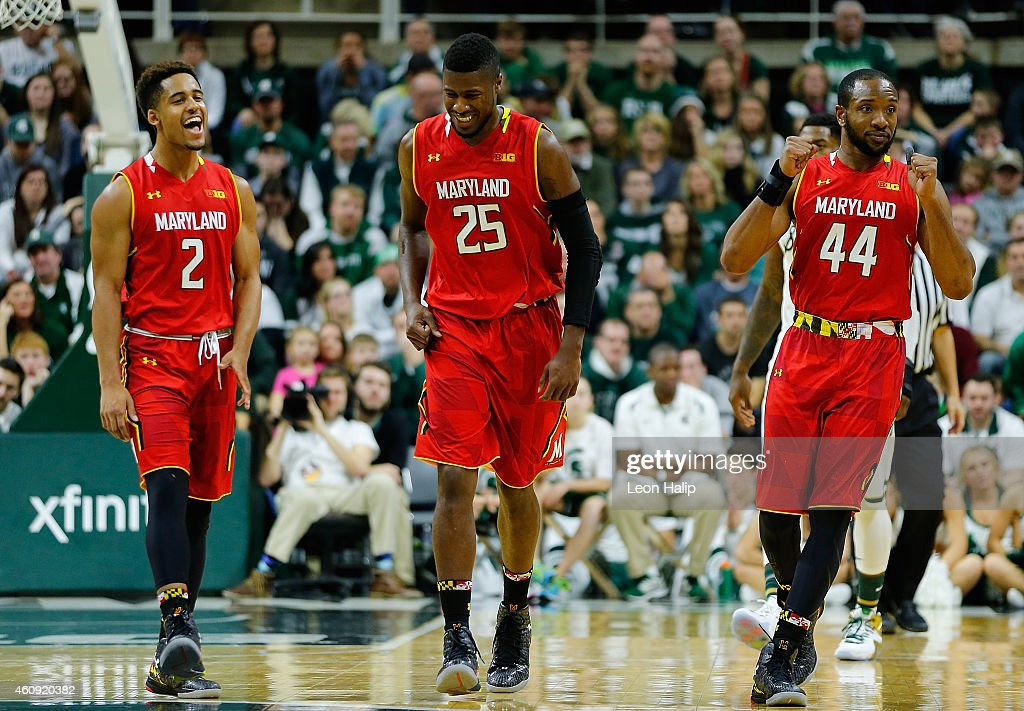 Melo Trimble Jonathan Graham and Dez Wells of the Maryland Terrapins celebrate a win over the Michigan State Spartans at the Breslin Center on...
