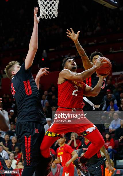 Melo Trimble of the Maryland Terrapins attempts a shot between CJ Gettys and Corey Sanders of the Rutgers Scarlet Knights during the first half of an...
