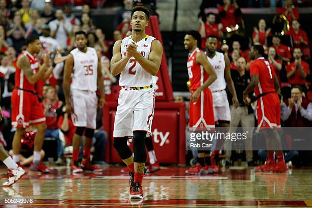 Melo Trimble of the Maryland Terrapins celebrates after the Terrapins scored against the Ohio State Buckeyes in the first half at Xfinity Center on...
