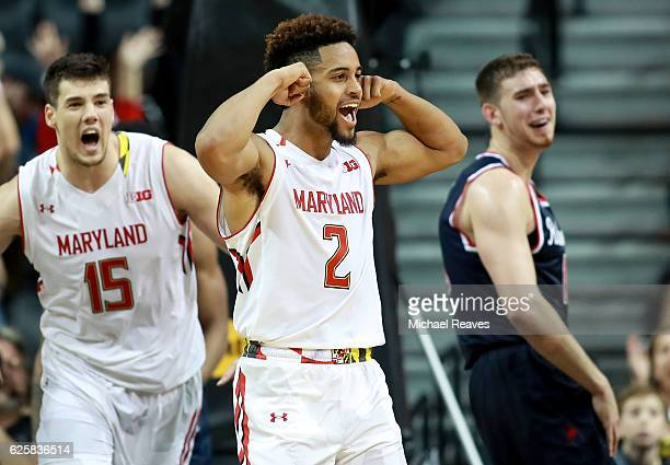 Melo Trimble of the Maryland Terrapins celebrates with Michal Cekovsky after a basket against the Richmond Spiders in the second half during the...