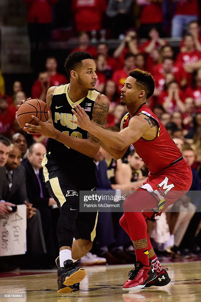 Melo Trimble #2 of the Maryland Terrapins defends Vince Edwards #12 of the Purdue Boilermakers in the second half during their game at Xfinity Center on February 6, 2016 in College Park, Maryland. The Maryland Terrapins defeated the Purdue Boilermakers 72-61.