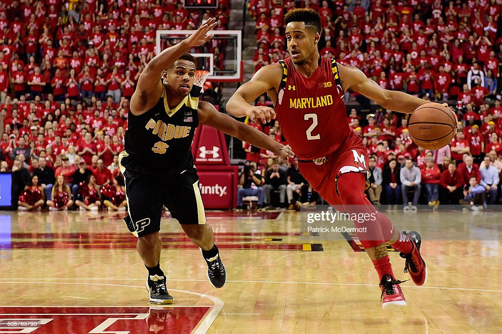 Melo Trimble #2 of the Maryland Terrapins dribbles the ball against P.J. Thompson #3 of the Purdue Boilermakers in the second half during their game at Xfinity Center on February 6, 2016 in College Park, Maryland. The Maryland Terrapins defeated the Purdue Boilermakers 72-61.