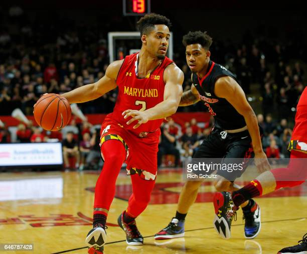Melo Trimble of the Maryland Terrapins in action against Corey Sanders of the Rutgers Scarlet Knights during an NCAA college basketball game at...